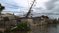 Cyclone aftermath flooded streets downed power poles - stock footage