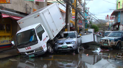 Typhoon Haiyan (Yolanda) storm surge truck lands vehicle Stock Footage