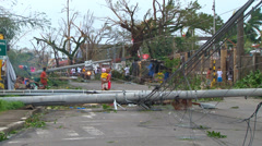 Typhoon haiyan yolanda aftermath poles blocking road Stock Footage