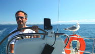 Stock Video Footage of Skipper on sailing boat with seagull on Adriatic sea off the coasts of Croatia.