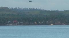 Typhoon haiyan yolanda storm surge remote village helicopter Stock Footage