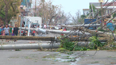Super Typhoon aftermath fallen concrete power poles Stock Footage