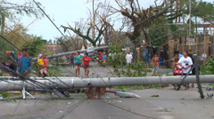 Typhoon hurricane aftermath power poles block streets Stock Footage