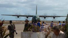 Typhoon haiyan yolanda c130 relief aid arrives Stock Footage