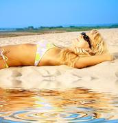 Tanning blonde in sunglasses Stock Illustration