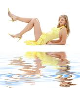 Laying girl in yellow dress on white sand Stock Illustration