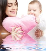 baby and mama with heart-shaped pillow - stock illustration