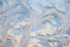 Stock Photo of painting on the frozen window by frost - nobody