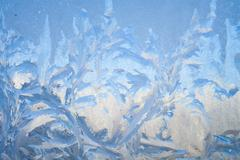 Painting on the frozen window by frost - nobody Stock Photos