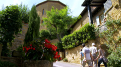 Tourists visiting the small town of Ternand France (1) Stock Footage