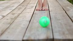 Barefoot Girl Playing Toy Ball HD - stock footage