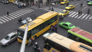 Stock Video Footage of Tehran, Iran, chaotic junction with buses, cars, pedestrians, motorbikes