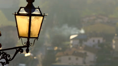 Wrought iron lamppost at sunset. - stock footage