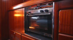 Pendular oven in cabin of sail boat Stock Footage