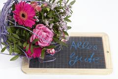 A floral bouquet of roses and a gerbera Stock Photos