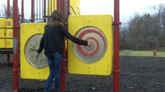 Young girl playing at the playground Stock Footage