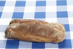 Bread on a checkered tablecloth Stock Photos