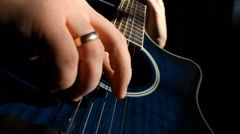 Acoustic guitar plucking close up Stock Footage