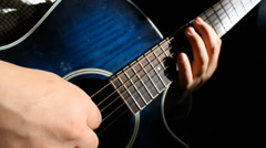 Acoustic chord playing close up Stock Footage