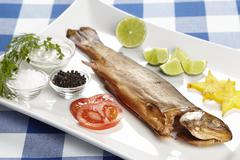 Smoked trout with spices, herbals and trimming Stock Photos