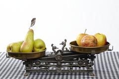 Compare apples to pears Stock Photos