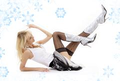 Laying blonde in silver boots Stock Illustration