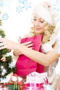 Stock Illustration of santa helper girl decorating christmas tree