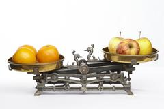compare apples to oranges - stock photo