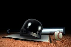 baseball equipment and base on the field - stock photo