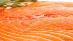 Piece of salmon fillet and rosemary Stock Footage