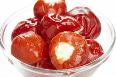 Stuffed cherry tomatoes Stock Photos