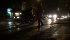 Tehran, girl crosses busy street at night Stock Footage