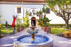 Mexican tile fountain serra statue garden mission san buenaventura ventura ca Stock Photos
