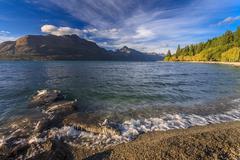beautiful lake wakatipu against blue sky - stock photo