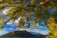 Beautiful lake wakatipu against blue sky Stock Photos