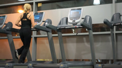 Young woman running in a gym Stock Footage