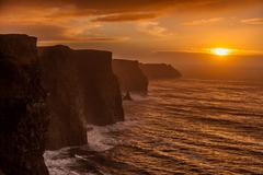 Cliffs of moher at sunset in co. clare, ireland europe Stock Photos