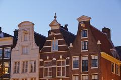 Amsterdam, netherlands - gables in the evening Stock Photos