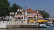 Stock Video Footage of AMSTERDAM  restaurant at waterfront near CS + departing canal cruise ship