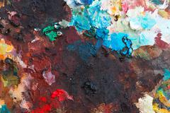colorful background made oil paints on a wooden - stock photo