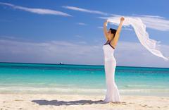 happy woman with white sarong - stock photo
