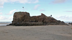 Small rocky island on the beach Stock Footage
