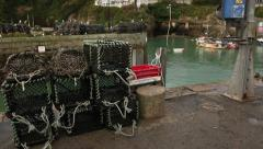 Fishing pots on the harbour wall Stock Footage