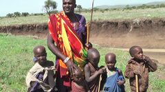 Chief of masai tribe with children standing in savanna, Tanzania Stock Footage