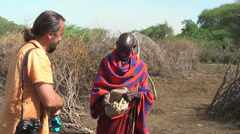 First meeting and greeting with Masai tribe head in village, Tanzania Stock Footage