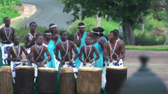 Masai children with drums playing for quests, Rwanda Stock Footage