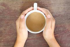 coffee cup in woman hand - stock photo