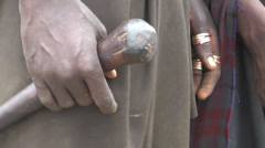 Hands of masai adolescents warriors with stick Stock Footage