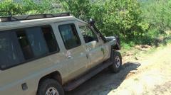 Car that stuck in the road dirt while safari, Tanzania, Africa Stock Footage
