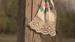 Close up of towel on wooden cross Stock Footage